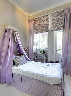 What little girl doesn't love purple? Purple is added here in the right doses and the kid can grow with it. I think this bedroom is just lovely!