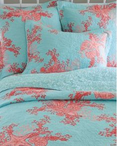 Coral and teal comforter...love the beachiness of this!