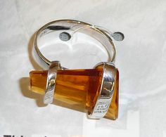 Handmade silver and Amber ring.  Made by Irasema Ramirez. I saw this at a Mexican Artisan show at padre Island, Tx. It's beautiful!