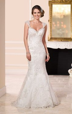 Calling all brides-to-be, this lace over satin wedding dress from Stella York boasts sparkling Diamante accents along its sweetheart neckline and a sexy low back.