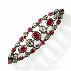 Georgian Ruby and Diamond Brooch - A rare and radiant survivor from the days of yore - circa 1800. 16 bright red, foil-backed rubies alternating with 15 bright-white, rose-cut diamonds are arrayed over an elegantly fashioned navette shape brooch, hand fabricated in silver, a long time ago. This ravishing, Georgian-era, museum worthy jewel measures 2 and 3/16 inches by 5/8 inch.