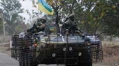 Ukrainian soldiers patrol in a APC in the eastern Ukrainian city of Kramatorsk, Donetsk region on 11 September 2014.
