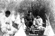 Native American girls learning the art of tepee construction whilst at play.