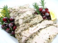 Tender and Juicy Rosemary Turkey Breasts Made In a Crock Pot...Great for a small gathering...It's so easy to make because it's going in the crock pot. Each skinny serving has 221 calories, 1 gram of fat and 5 Weight Watchers POINTS PLUS. The leftovers make great sandwiches too.