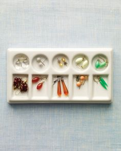 Ceramic watercolor palettes provide perfect slots for sorting and separating earrings and other jewelry -- with no tangles.   Available at art-supply stores (fineartstore.com), they make delightful displays on dressers when filled with colorful gems. They're also small enough to tuck in a drawer.