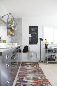 Rug runners can look great in the kitchen - we have some gorgeous ones that would look fantastic in an otherwise minimalist space