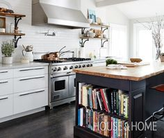 "Lynn Crawford's Kitchen | House & Home A dark wood floor and island are practical and chic.   ""Make your stove the focal point of the space,"" advises chef Lynn Crawford of HGTV. ""My kitchen island, sink and seasonings are right beside the stove, so all I have to do is pivot!"" The butcher-block countertop on the island (which incorporates generous cookbook storage) makes it look unfitted and authentic, just the place for a professional to get to work."