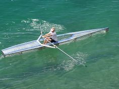 A clear rowing shell - it looks very serene with this clear water