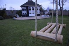We've collected a list of some of the best DIY porch swing plans that you can build yourself with links to the printable designs. Bamboo Poles, Bamboo Art, Bamboo Crafts, Bamboo Fence, Bamboo Ideas, Backyard Garden Landscape, Small Backyard Gardens, Garden Web, Balcony Garden
