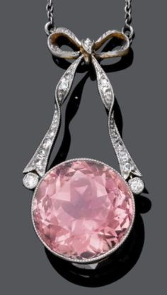 TOURMALINE AND DIAMOND NECKLACE, ca. 1890.  Silver over pink gold.  Decorative necklace of 1 fine, round, light pink tourmaline, mounted on 1 bow motif set with 2 old European cut diamonds and numerous rose-cut diamonds. On a fine anchor chain. #antique #BelleEpoque #pendant