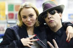 Lily Rose Depp (Johnny Depp's daughter) and Marilyn Manson.