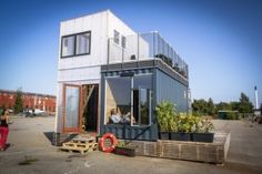 Container Home Village in Copenhagen 3 x 20 footers together. Love the deck!
