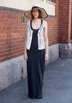 """Iina, 16 """"My hat is from Zara, the dress and the vest from Vila and the shoes Crocs. Normally I don't wear dresses, but t-shirts and shorts. My style is quite masculine, but I do get inspired by feminine vintage looks as well."""" 9 June 2013, Lönnrotinkatu"""