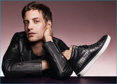 Holding a pair of leather high-top sneakers, James Jagger is front and center for Jimmy Choo's fall-winter 2016 men's campaign.