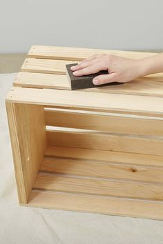 Sanding wooden crate for bathroom storage project
