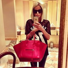 Caroline Stanbury.. Givenchy top, with Celine tote and glasses..