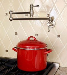 Smart planning makes it more affordable to include special features such as this useful pot-filling faucet above the stove. By Kathy Barnes