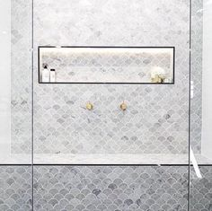 Bathroom shower of your dreams! Fish scale marble mosaic feature wall with matte black trims and brass tapware.
