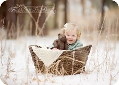 toddler and her teddy in the snow I have a white basket - good for keeping somebody in one place for a portrait!