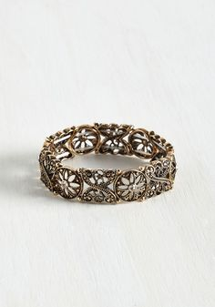 At Your Bedeck and Call Bracelet. You can always rely on this antiqued-gold stretch bracelet to complete any outfit!  #modcloth