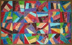 Details of squares are labeled using a grid system starting at the upper right corner with A1. Rows in this quilt go down to F, and there ar...