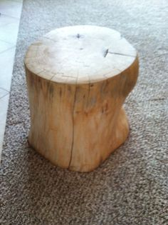 Light colored wood stump.  For sales inquiries, please email abelcathy@aol.com  www.cathyabelomalleyinteriors.com