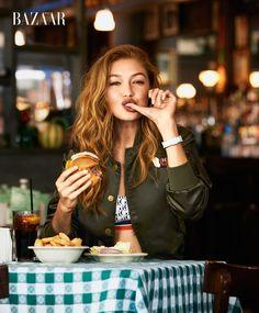 Gigi Hadid wears Tommy Hilfiger x Gigi bomber jacket and bralette More