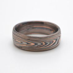 Mokume Ring In Palladium, 14kt Red Gold and Oxidized Silver with wood grain pattern and etched, oxidized finish