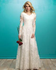 Demure lace sleeves lend a classic look to this sleek modest gown. #StyleOfTheWeek #modestdress #weddingdress #wedding #utahbrides #modestbrides #allurebridals #petalsandpromises #petalsandpromisesbridal