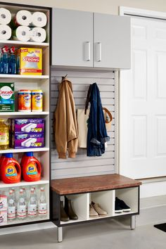 Dedicate a space next to the door to hang coats, umbrellas and hats. Include an inviting bench to take shoes on and off or set shopping bags before entering your home. Garage Organization Systems by ORG Home Garage Renovation, Garage Interior, Garage Remodel, Garage Makeover, Garage Cabinets Diy, Garage Organisation, Garage Storage Solutions, Home Organization, Organized Garage