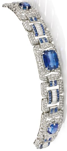 An Art Deco sapphire and diamond bracelet, 1930s. Of openwork geometric design set with cushion-shaped and calibré-cut sapphires and circular-cut and baguette diamonds.