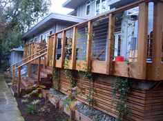 """This is a great blending of modern, yet classic arts & crafts workmanship. this vines will """"hide"""" the under-decking as they grow, yet provide peeks to the above standard work."""