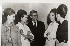 1960 - Yves Saint Laurent & Models after the Dior presentation in London