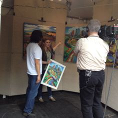 KHOU reporter Courtney Perna interviewing BCAF featured artist Daniel Ng in his booth at the Bayou City Art Festival on the first day about the art work displayed on all of the BCAF posters. #DanielNg #CourtneyPerna #HouArtFest #ArtColony #KHOU #GreatDayHouston