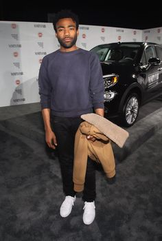 Or to bother putting it away for a photo. | Attention: Donald Glover Has Been Looking Super Fine In 2015