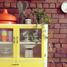 Love this lemony yellow kitchen or bathroom cabinet