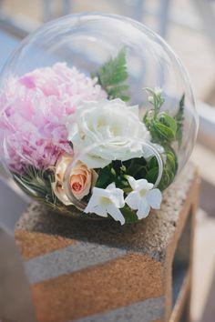 glass bowl floral arrangements, photo by Rad + In Love http://ruffledblog.com/kona-kai-resort-wedding #weddingideas #weddingflowers