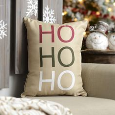 """Kirkland's """"Ho Ho Ho"""" Accent Pillow features simple text in red, green and white, but it's still a fun addition to your couch for Christmas!"""