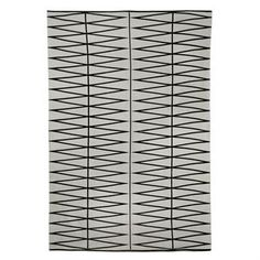 Update your living room with the stylish grey cotton rug with black graphic pattern from Bloomingville. The rug has a modern look that fits most homes and environments and is easy to mix and match with other interior details!