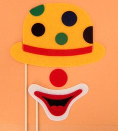 Photobooth clown props... I like the decorated hat & the big smile.