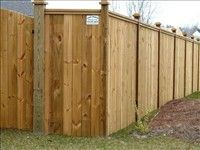 Custom wood design privacy fence with caps<br>