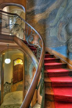 Art Nouveau staircase in Hotel Hannon, Brussels Belgium. Ironworks by Pierre Desmedt and frescoes by Paul Albert Baudouin