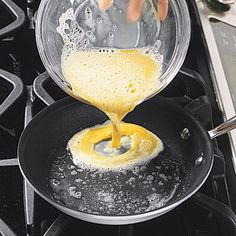 In 8-inch nonstick skillet, melt margarine on medium. When margarine stops sizzling, pour or ladle 1/2 cup egg mixture into skillet.