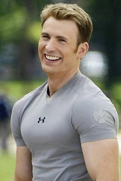 Chris evans on set of the winter soldier. his hairoh my goshand notice how the shield symbol is on the sleeve of the shirt.