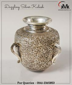 The sacred essential of home,pure silver kalash and the graceful curves add to its alluring beauty. Crafted from high quality silver with ever shining grace. You can also gift these lamps to your loved ones to cherish the sparkling smile on their face.  #meta #jewel #silver #jewellery #box #kalash #roses #pooja #thali #jali #tray #basket #jar #barni #table #watch #candle #stand #corporate #gift #pinkcity #jaipur #rajasthan