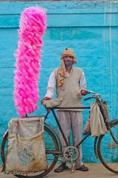 Cotton Candy vendor In India, Cotton Candy is known as 'Buddhi ke baal' (Old woman's hair) or Bombay Mithai. He looks so proud. In This World, We Are The World, People Of The World, Beautiful World, Beautiful People, Beautiful Flowers, Amazing India, Varanasi, India Travel