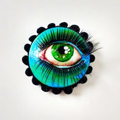 Neon Ghost brooch - acrylic and paper clay on wood disc with fabric trim and lashes
