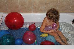 Bath Time Fun - water balloons in the bathtub