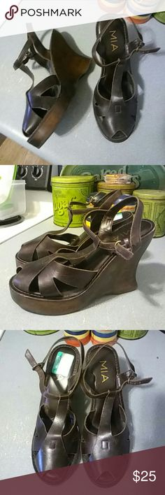 Mia Brown Leather Wooden T Straps. Sz 8 Mia Brown Leather Wooden T Straps. Sz 8  Worn a few times. Light if any signs of wear. I don't wear these enough to keep. MIA Shoes Wedges