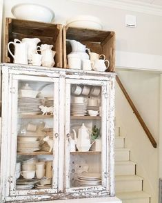 Farmhouse cupboard with ironstone collection.